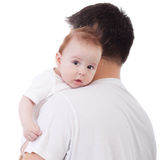 Baby on shoulder. Adorable baby looking over father's shoulder, isolated on white Stock Photo
