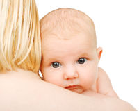 Baby on shoulder of her mother Stock Photo
