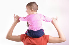 Baby on shoulders Stock Photo