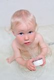 Baby with shower stock photo