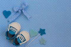 Baby shower background. Baby boy blue card. Newborn background. Baby shower invitation. Fondant baby accesories Stock Image