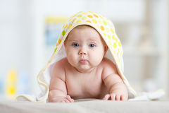 Baby after shower or bath with towel on head Stock Photo