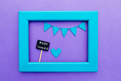 Baby Shower -blackboard sign on purple background with turquoise frame and bunting Stock Photography