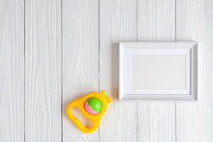Baby shower - blank picture frame on wooden background stock photography