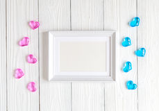 Baby shower - blank picture frame on wooden background. Top view Stock Photos