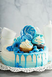 Baby shower or boy birthday cake. With blue decorations stock image