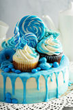 Baby shower or boy birthday cake. With blue decorations stock photos