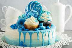 Baby shower or boy birthday cake. With blue decorations royalty free stock images