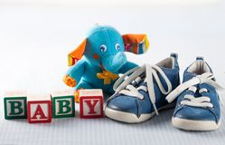 Baby Shower. Baby Boys Baby Booties Shoe Toy Blue Block Stock Image