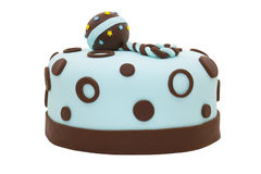 Baby shower cake. Baby shower fondant cake with a rattle on top Royalty Free Stock Photography