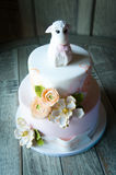 Baby shower cake with lamb and flower topper Royalty Free Stock Image