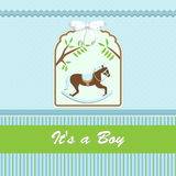 Baby shower card, for baby boy, with rocking horse and blue-green background Royalty Free Stock Photo