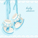Baby shower card with blue booties Royalty Free Stock Photography