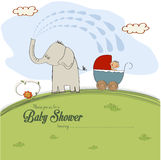 Baby shower card with a boy in stroller sprayed by an elephant Royalty Free Stock Image