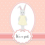 Baby shower card with bunny girl and polka dots background. It's a girl - lettering quote. Birthday party. Stock Images