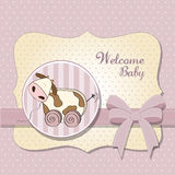 Baby shower card with cute cow toy Stock Photo