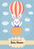 Baby shower card with a cute rabbit flying on balloon Royalty Free Stock Image