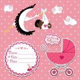 Baby shower card,invitation,scrapbook with stork a. Stork  flying with mulatto newborn baby girl.Baby shower card,invitation,scrapbook  with label,copy space Stock Image