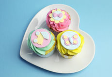 Baby shower or childrens pink, aqua & yellow cupcakes - aerial Royalty Free Stock Image