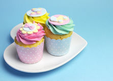 Baby shower or childrens pink, aqua & yellow cupcakes - with copyspace Stock Images