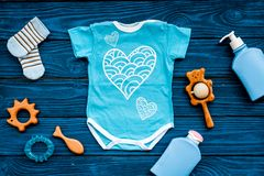 Baby shower concept. Baby`s clothes and toys on blue wooden background top view. Clothes for boy. Baby shower concept. Baby`s clothes and toys on blue wooden royalty free stock photography