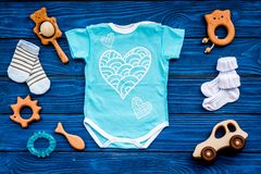 Baby shower concept. Baby`s clothes and toys on blue wooden background top view. Clothes for boy. Baby shower concept. Baby`s clothes and toys on blue wooden royalty free stock photos