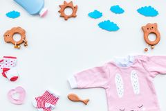 Baby shower concept. Baby`s clothes and toys on light background top view copy space royalty free stock photography