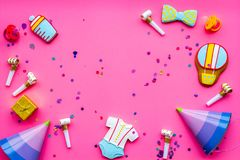 Baby shower. Cookies in shape of accesssories for child, party hats and confetti on pink background top view space for. Baby shower. Cookies in shape of stock photo