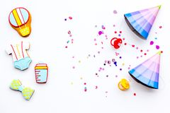 Baby shower. Cookies in shape of accesssories for child and party hats on white background top view copy space. Baby shower. Cookies in shape of accesssories for royalty free stock photo