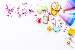 Baby shower. Cookies in shape of accesssories for child and party hats on white background top view copy space. Baby shower. Cookies in shape of accesssories for royalty free stock photos