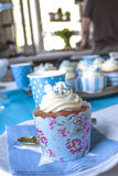 Baby shower cup cake. One blue cupcake, at a baby shower table royalty free stock photo