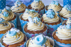 Baby shower cup cakes. Blue baby shower cup cakes, with different baby style decorations stock photo