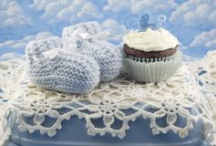 Baby Shower Cupcake and Booties for Boy royalty free stock photos