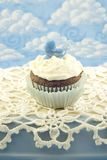 Baby Shower Cupcake for Boy. A delicious chocolate cupcake with creamy vanilla frosting for a baby shower for a boy, vertical with copy space royalty free stock images