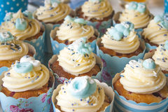 Baby shower cupcakes. It is a boy, A lot of blue baby shower cupcakes, decorated with baby stuff stock image