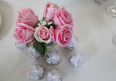 Baby Shower Gifts. Table with roses and baby shower gifts Royalty Free Stock Photo