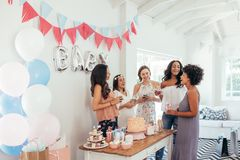 Baby shower. Group of diverse women together at . Smiling young pregnant women celebrating  with best friends Royalty Free Stock Photography