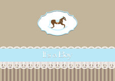 Baby shower invitation baby boy, with rocking hors Stock Photo
