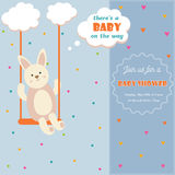 Baby shower invitation card with a bunny on the swing. Baby shower invitation card with a cute bunny on the swing Stock Image