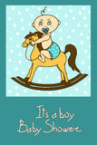Baby shower invitation card. With cute baby boy riding on a toy horse Royalty Free Stock Images