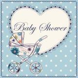 Baby shower med blå tappning för hjärta och för barnvagn Royaltyfri Bild