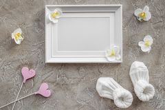 Baby shower modern design with frame on gray stone background top view mockup. Baby shower modern design with frame, clothes and toys on gray stone background royalty free stock photography