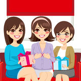 Baby Shower Party Family. Three beautiful women on a baby shower family party making presents to pregnant woman Royalty Free Stock Images
