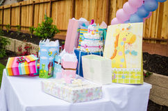 Baby shower presents on table Stock Photo
