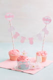 Baby shower sweet table. Butter cream cupcakes and cookie for a baby shower royalty free stock photos