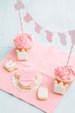 Baby shower sweet table. Butter cream cupcakes and cookies for a baby shower Stock Images