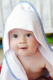 Baby after shower wrapped in towel. Baby age of 10 months after shower wrapped in towel Stock Photos