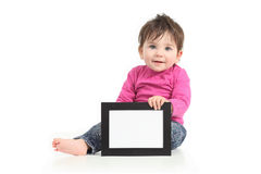 Baby showing a blank picture frame Royalty Free Stock Photos