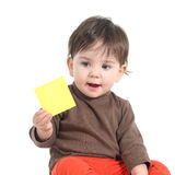 Baby showing a blank yellow note Stock Photography