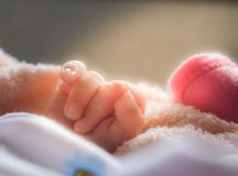 Baby is showing his fingers. Royalty Free Stock Photo
